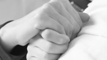holding ill hand
